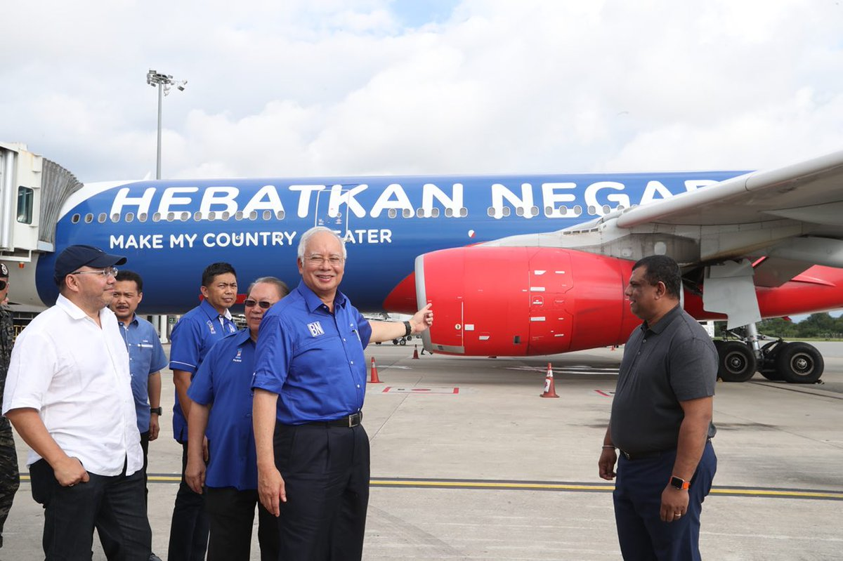 An Air Asia jet was painted in BN blue to welcome then Prime Minister Najib Razak.