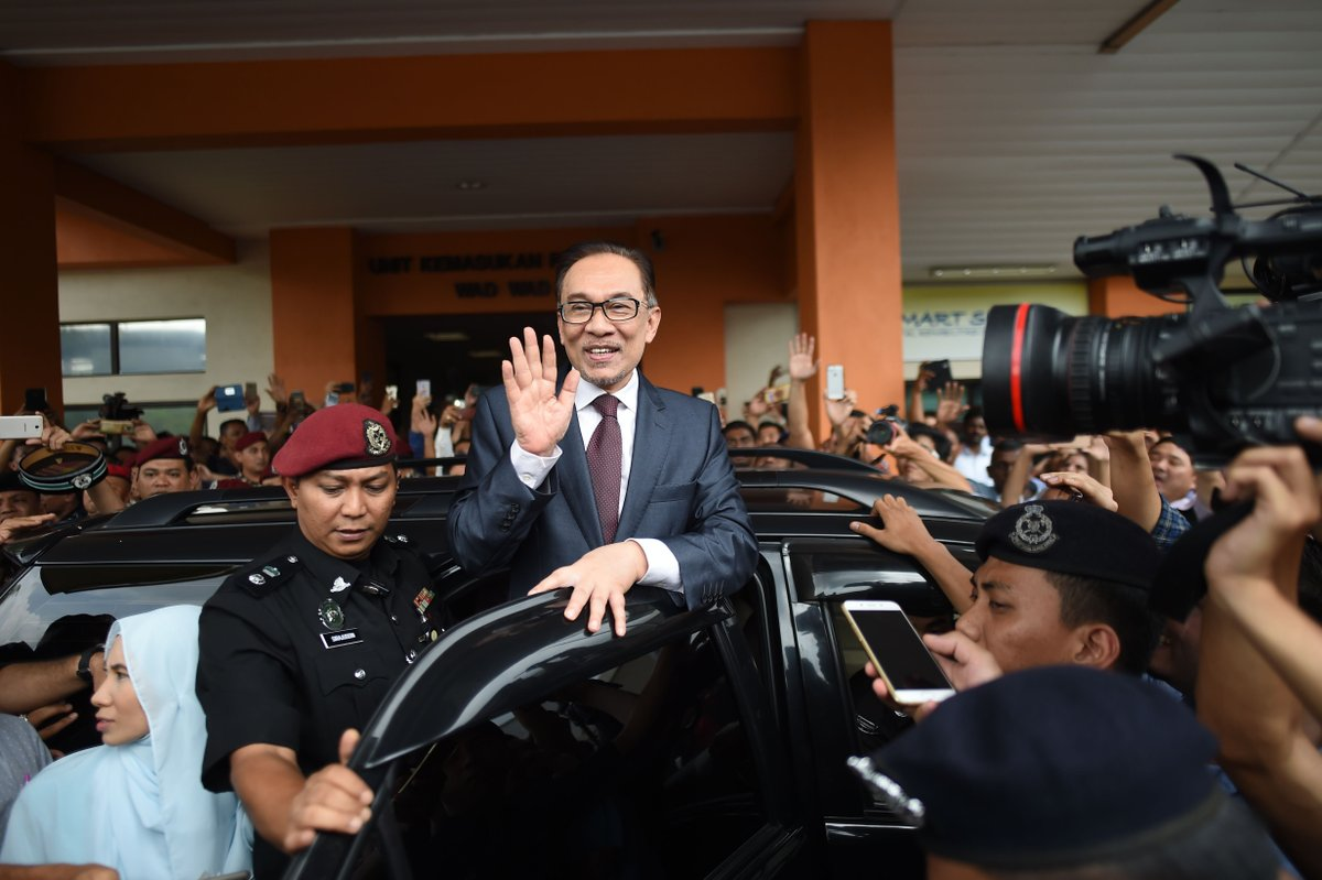 Jailed Malaysian Opposition Leader To Be Pardoned After His Party's Victory