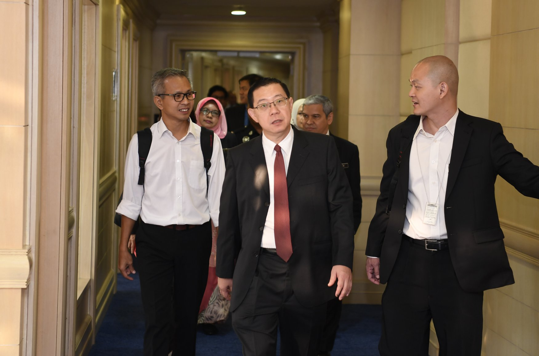 Tony Pua (left), Lim Guan Eng (middle), and Ong Kian Ming (right) at the Ministry of Finance on Tuesday, 22 May.