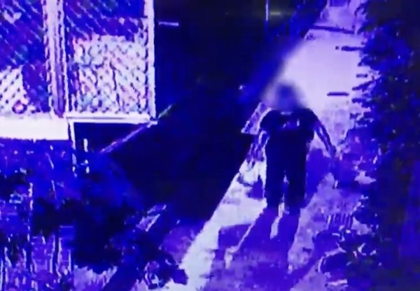 A screengrab of a surveillance footage showing Chu hiding Huang's dismembered body.