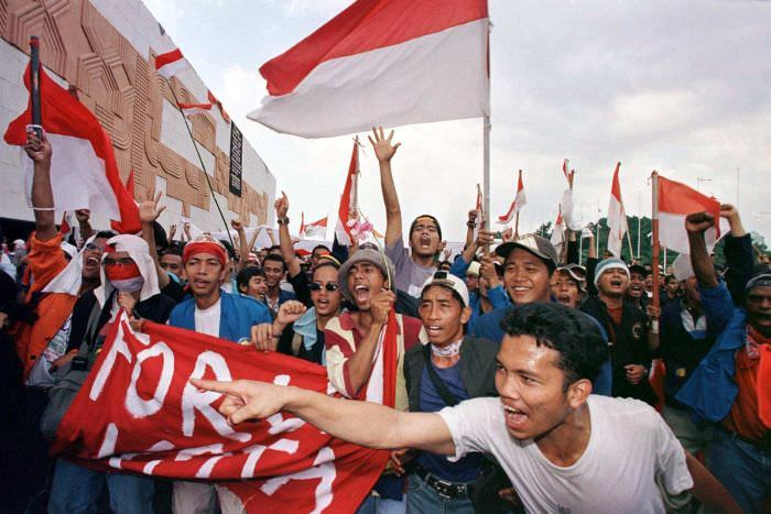 Indonesian students waving flags after the resignation of Suharto.
