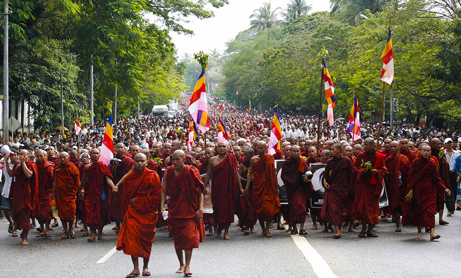 In 2007, Buddhist monks marched under the watch of security forces in Yangon.