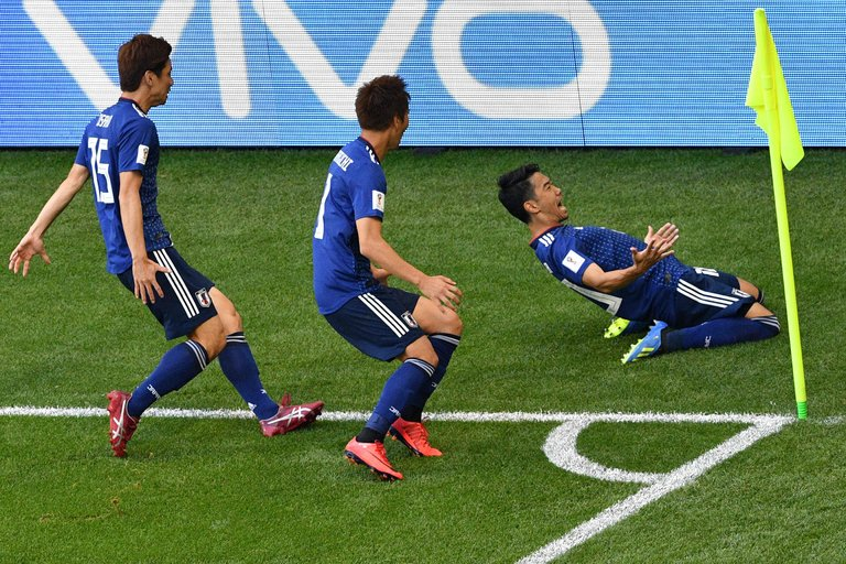 Japan's Shinji Kagawa celebrates his first-half goal against Colombia.