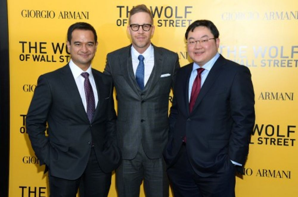 Najib's stepson Riza Aziz (left), and Jho Low at the The Wolf Of Wall Street premiere in 2013.
