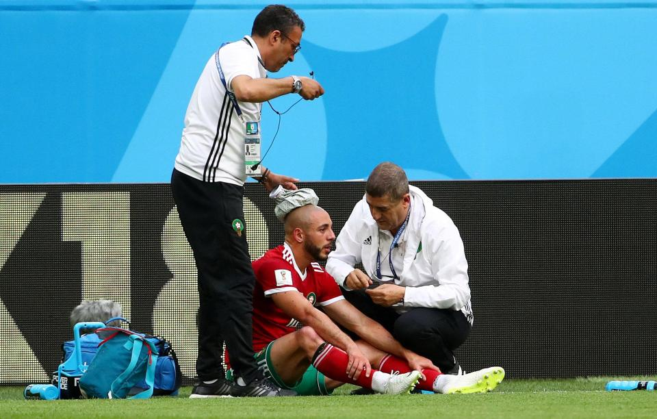 Amrabat receiving treatment during the 15 June match against Iran.