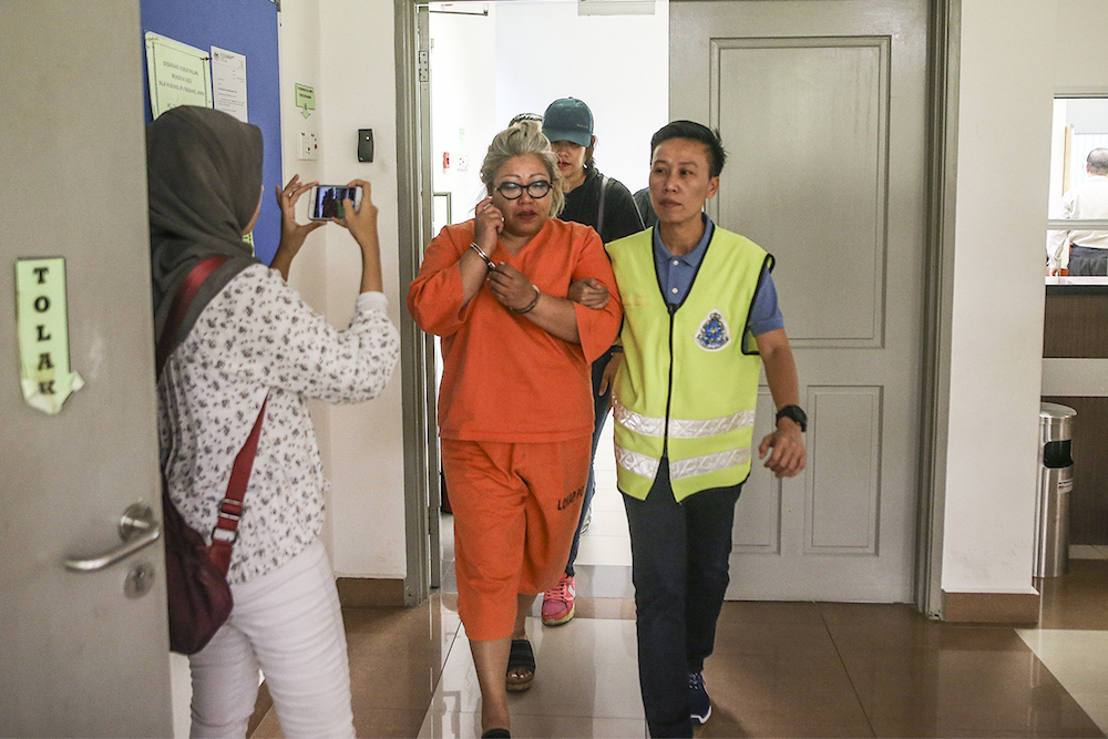 Siti Kasim is seen in the Kajang Court Complex earlier today.