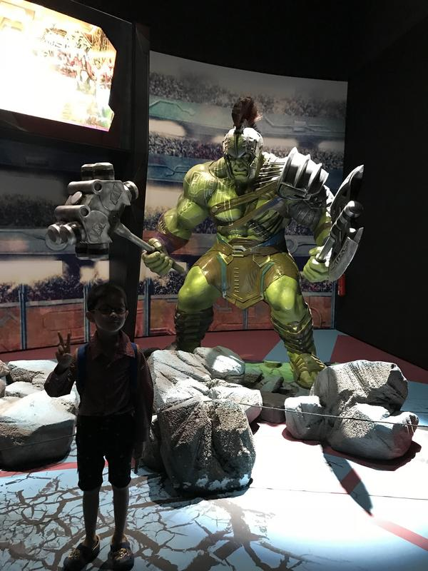 Boy takes pics with Hulk before Hulk battles it out with Thor