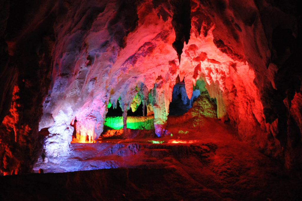 Jenolan Caves' Chifley Cave is illuminated with coloured lights.