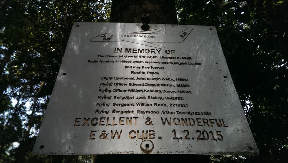 A memorial plate with the names of some of the crew members who were killed can be spotted at the scene.