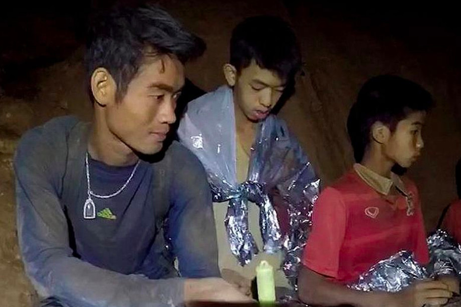 Ekapol Chanthawong (left) with the boys in the cave.