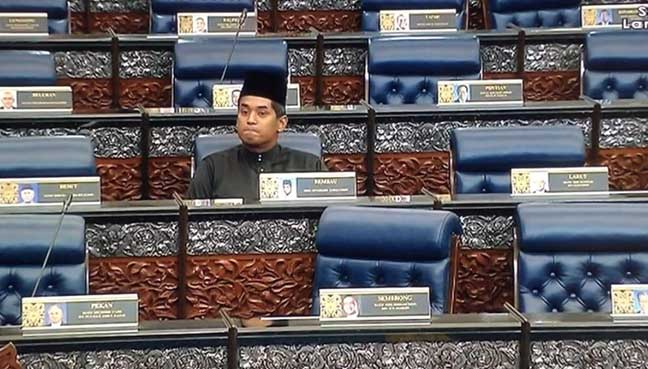 Khairy sat alone on the opposition bench after his fellow members of opposition walked out in protest.