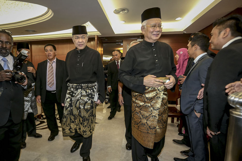 Ahmad Zahid and Najib reentered the Dewan Rakyat to take their oaths of office.