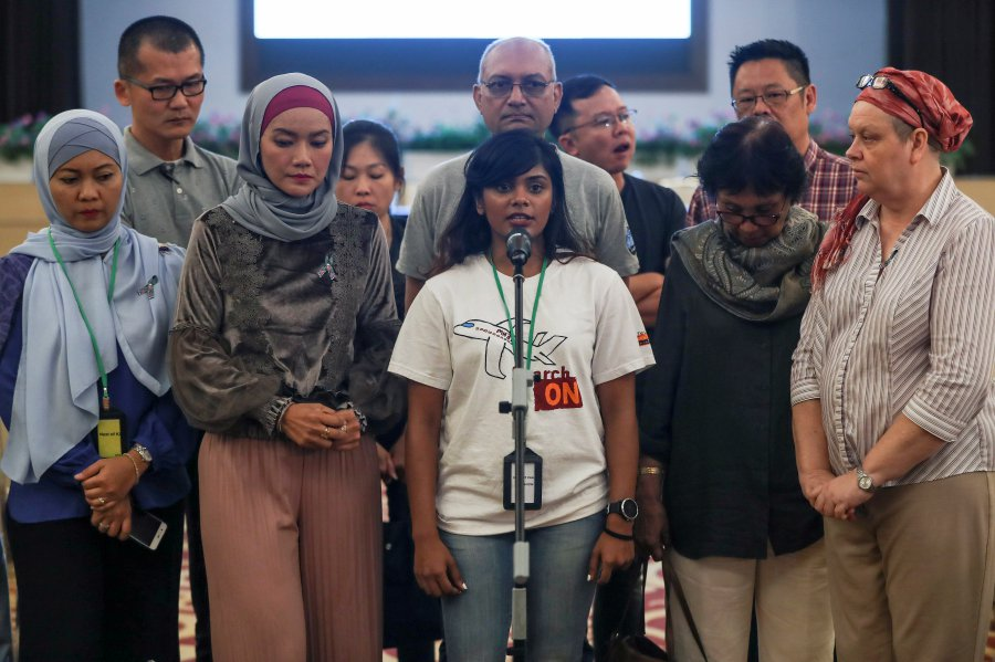 Grace Subathirai Nathan, (centre) daughter of missing Malaysia Airlines flight MH370 passenger Anne Daisy spoke to press members at the Ministry of Transport headquarters in Putrajaya on 30 July.