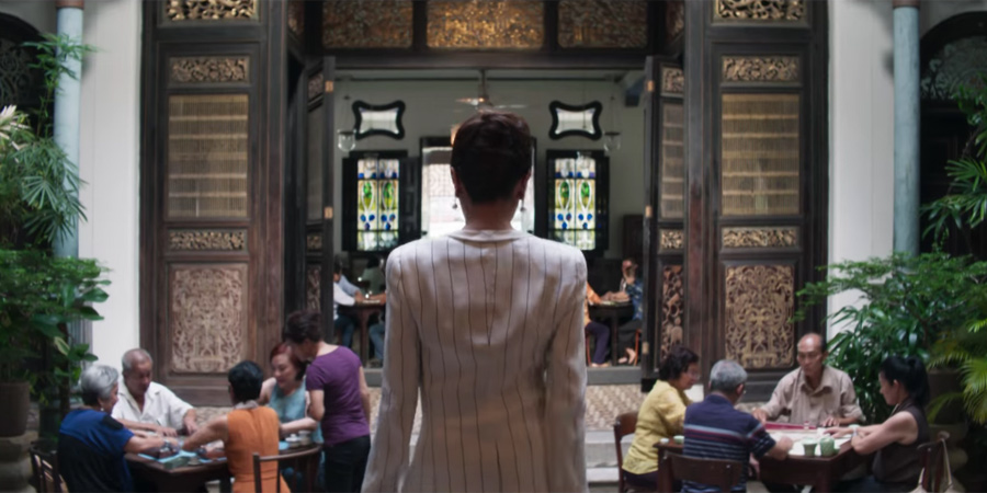 Michelle Yeoh (as Eleanor Young) walking into the mahjong scene shot in Cheong Fatt Tze Mansion in 'Crazy Rich Asians'.