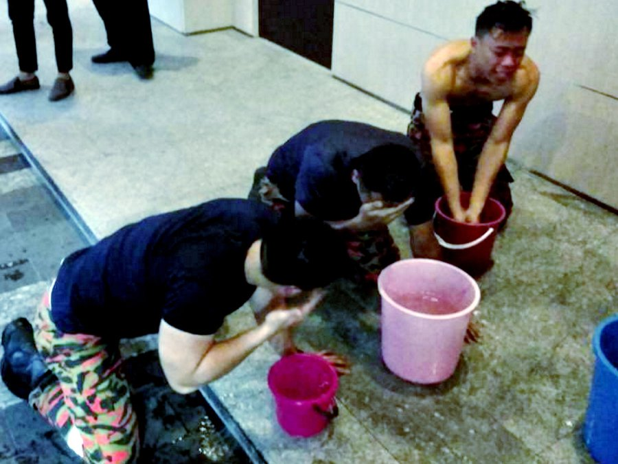 Firemen washing their faces after the pepper-spray attack.