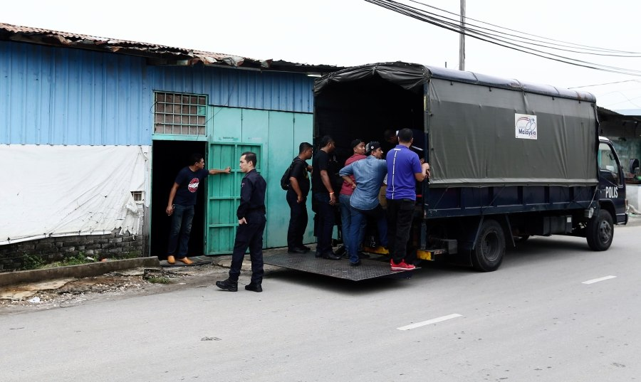 At least 20 boxes of various alcohol brands from two shops in Kampung Baru were confiscated today.