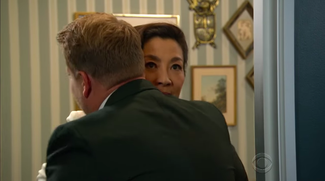 Michelle did not seem too pleased with James' hug.