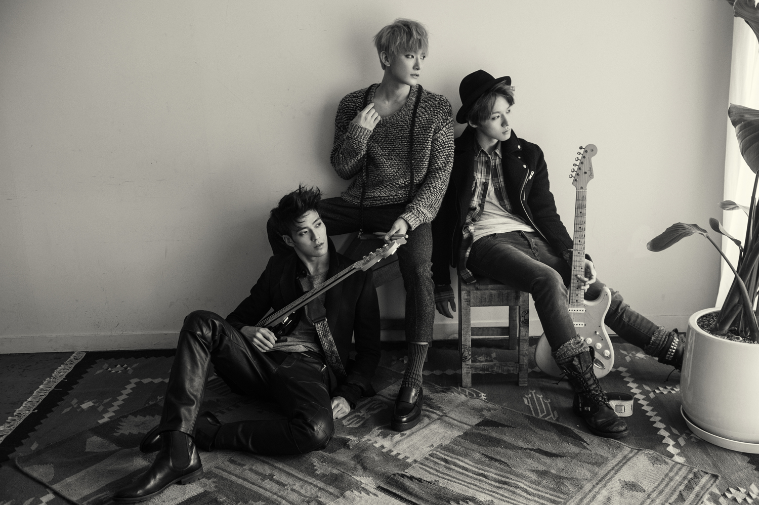 James (far left, sitting on the floor) with his former Royal Pirates bandmates Moon (far right) and Sooyoon (middle).