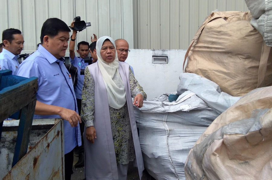 Housing and Local Government minister Zuraida Kamaruddin (in white headscarf).