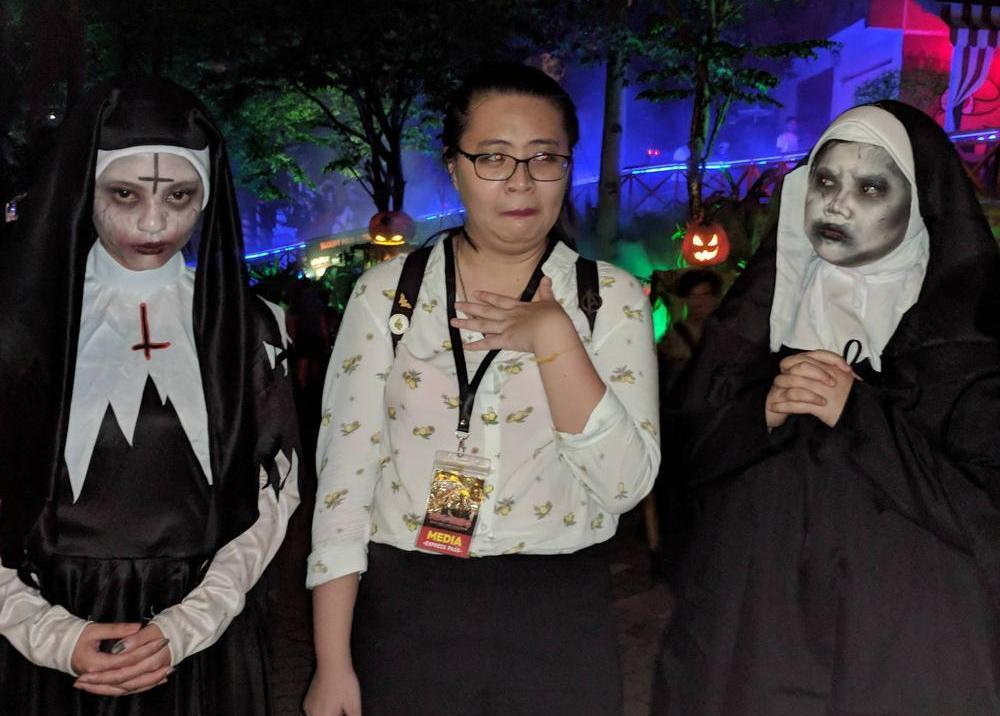 That's me getting flanked by the creepy nuns from The Nun. Halp.