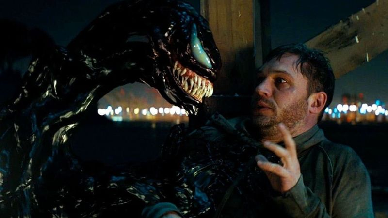 Venom confronts Eddie Brock (right, played by Tom Hardy) in 'Venom'.