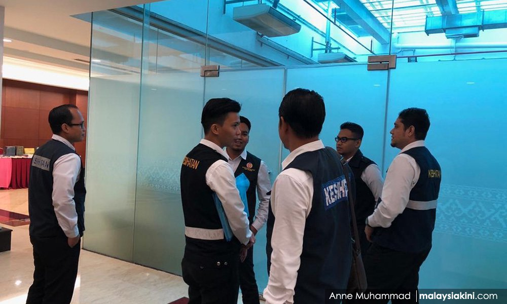 Enforcers from the Health Ministry monitoring outside the now defunct smoking room in Parliament.