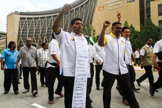 Taxi drivers protesting in front of the Finance Ministry in Putrajaya.