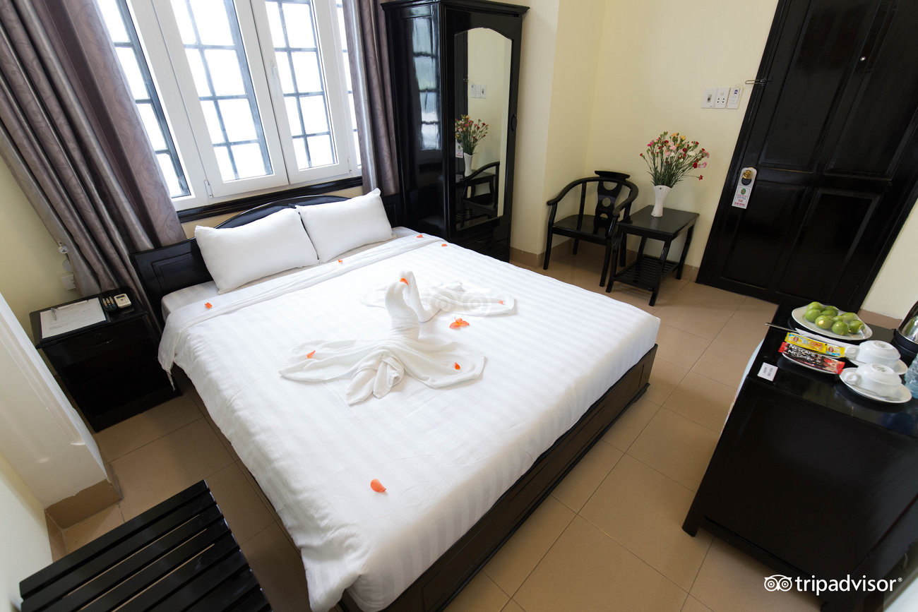 jade hotel hue shopping district vietnam clean bedroom