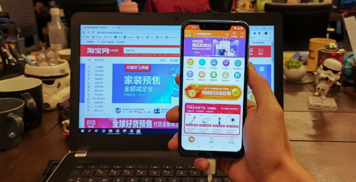 Taobao Lite Mobile App Holding Phone