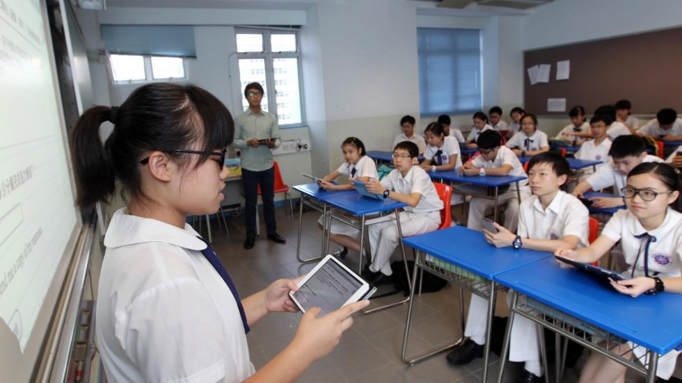 Photo of Form 1 students using their iPads in Hong Kong used for illustration purposes only.