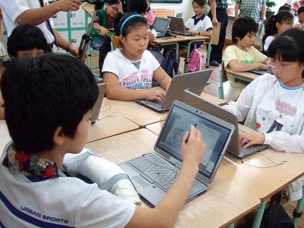 Photo shows pupils accessing e-textbooks on laptops at Gongsan Elementary School in Daegu, South Korea, in 2009.
