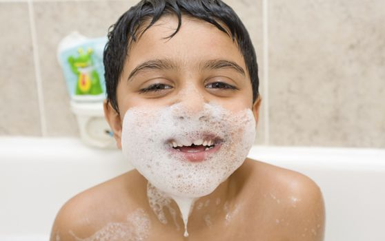 Indian kid with bubble moustache