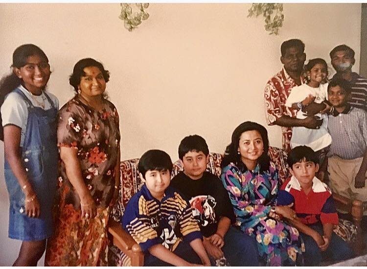 Johor Permaisuri Raja Zarith Sofiah (seated) and her children with Mohan and his family at their home on Deepavali day.