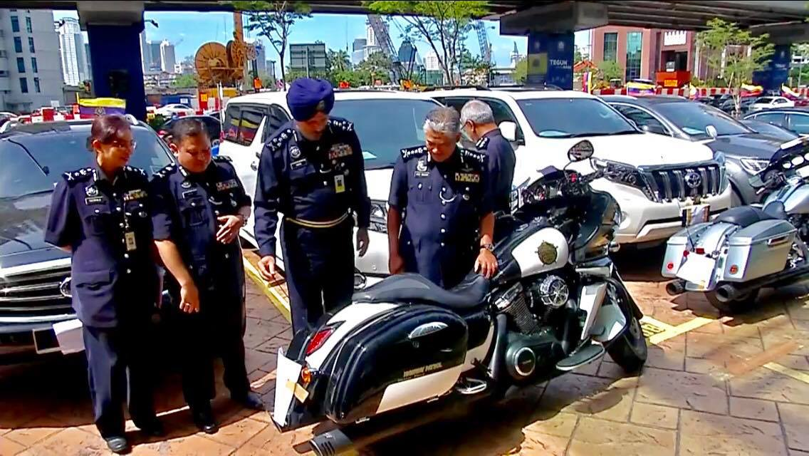 A file pic of Amar Singh inspecting a police motorcycle.