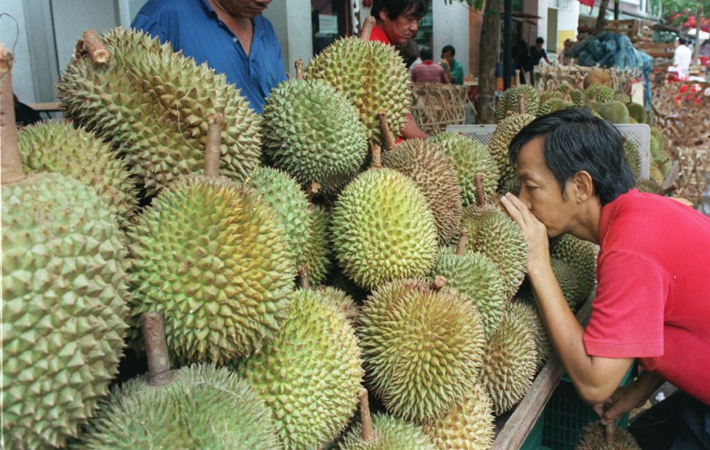 File photo of a customer leaning forward to smell durians.
