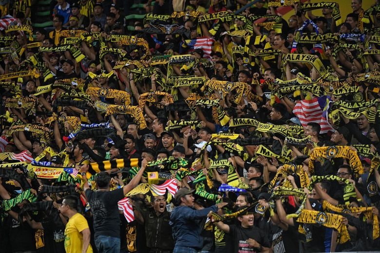 Malaysian fans chanting songs during the SEA Games football match between Singapore and Malaysia in 2017.