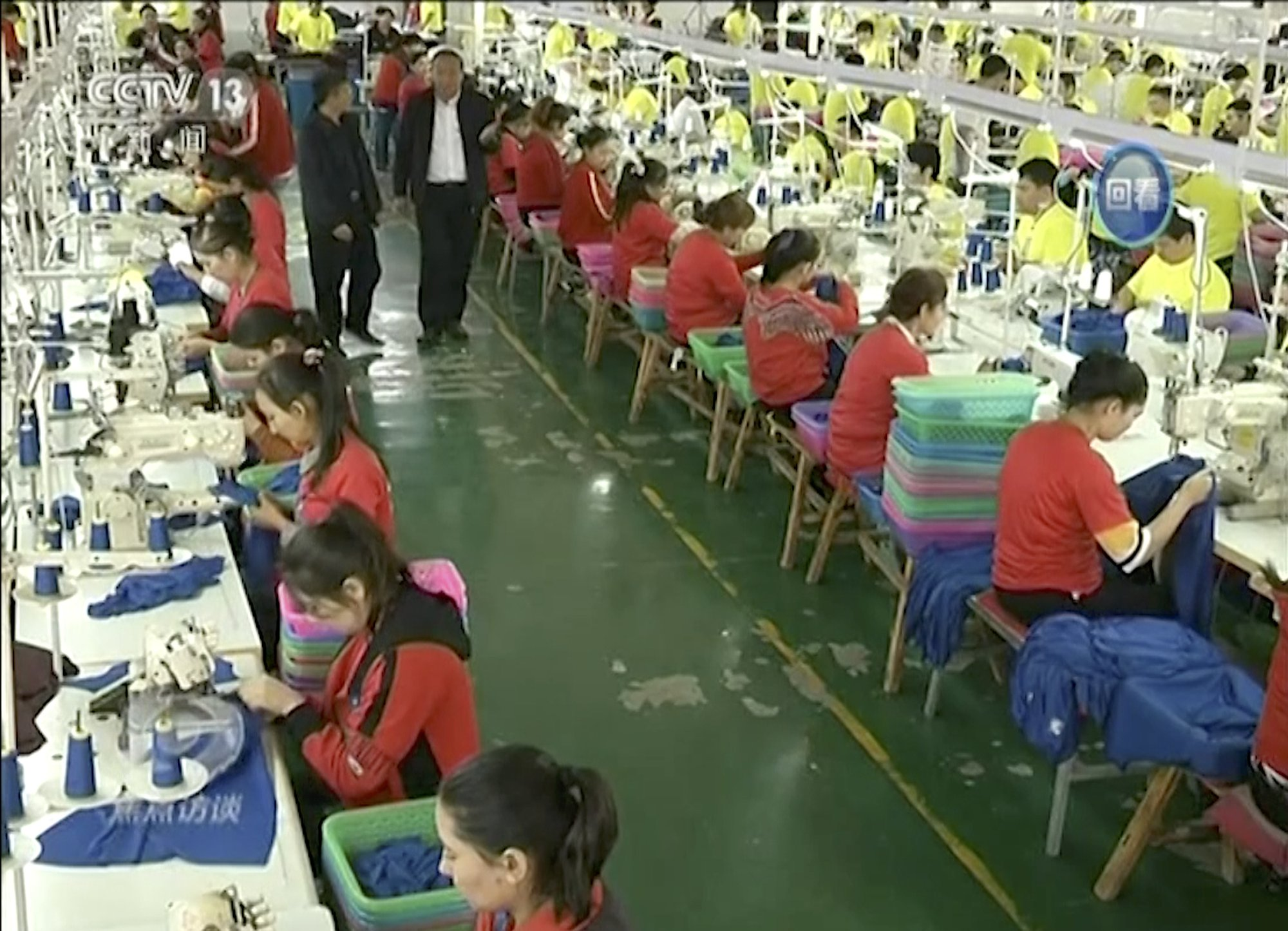 CCTV image of 'trainees' working at a garment factory.