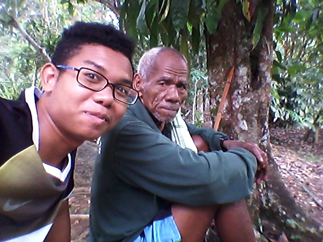 Agosly with one of the elderly residents in his village.