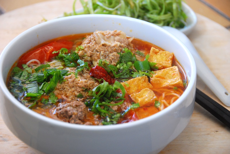 Bun rieu cua – a tomato-based crab noodle soup with rice noodles and dumplings made of crab and shrimp paste.
