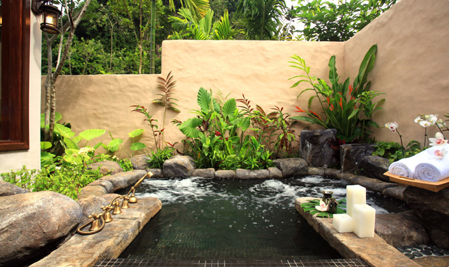 The Banjaran Hotsprings Retreat sunken hot tub with natural geothermal hotsprings water.