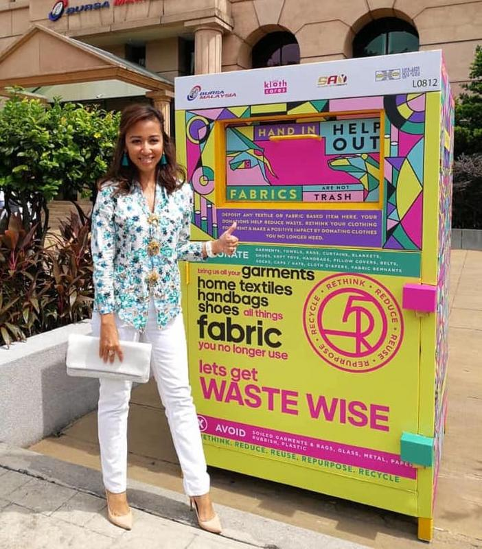 Y.A.M. Tengku Datin Paduka Setia Zatashah Idris with a Kloth Cares bin.