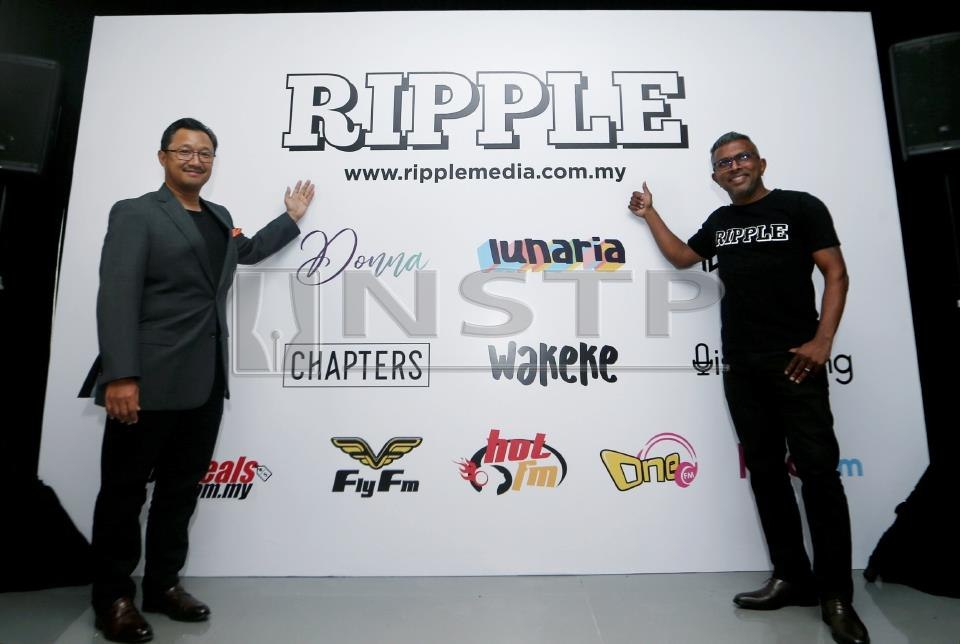 Media Prima's group managing director Datuk Kamal Khalid (left) and chief executive officer of Ripple Seelan Paul.
