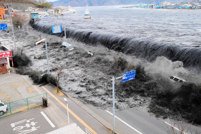 A wave approaches Miyako City from the Heigawa estuary in Iwate Prefecture after the magnitude 8.9 earthquake in March 2011.