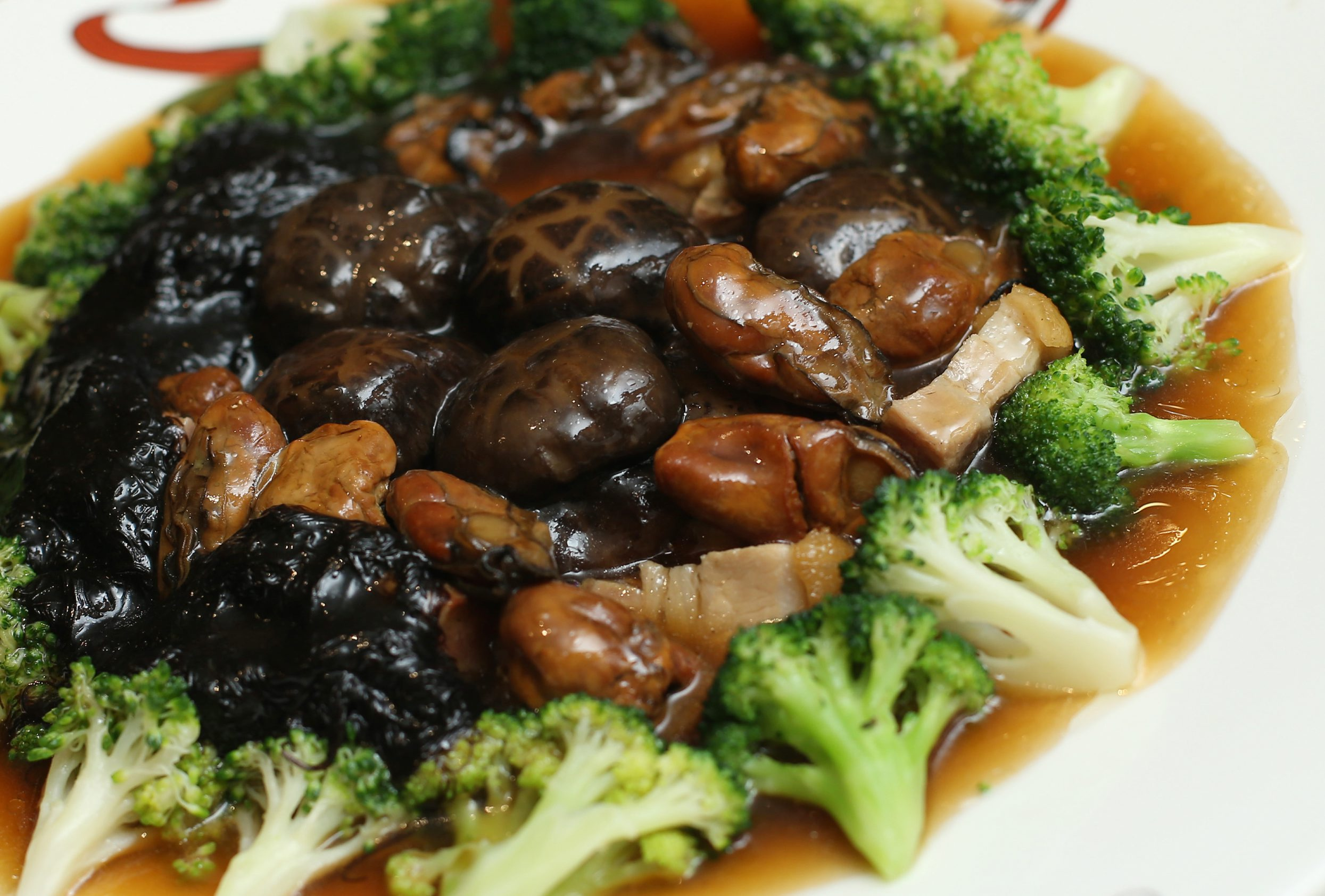 Fatt choy braised with flower mushrooms, sun-dried oysters, broccoli, and pork.