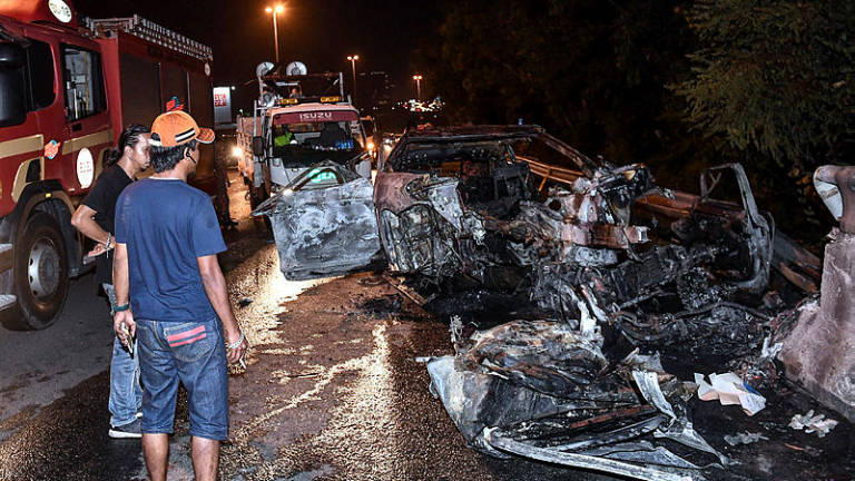 The burnt wreckage of the BMW following the crash at the SILK Highway on Tuesday.