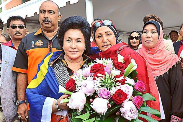 Datin Rosmah Mansor (left) standing with Suwaibah Muhamad Nasir (right) at Riva Sette De Marite in Venice, Italy in 2014.