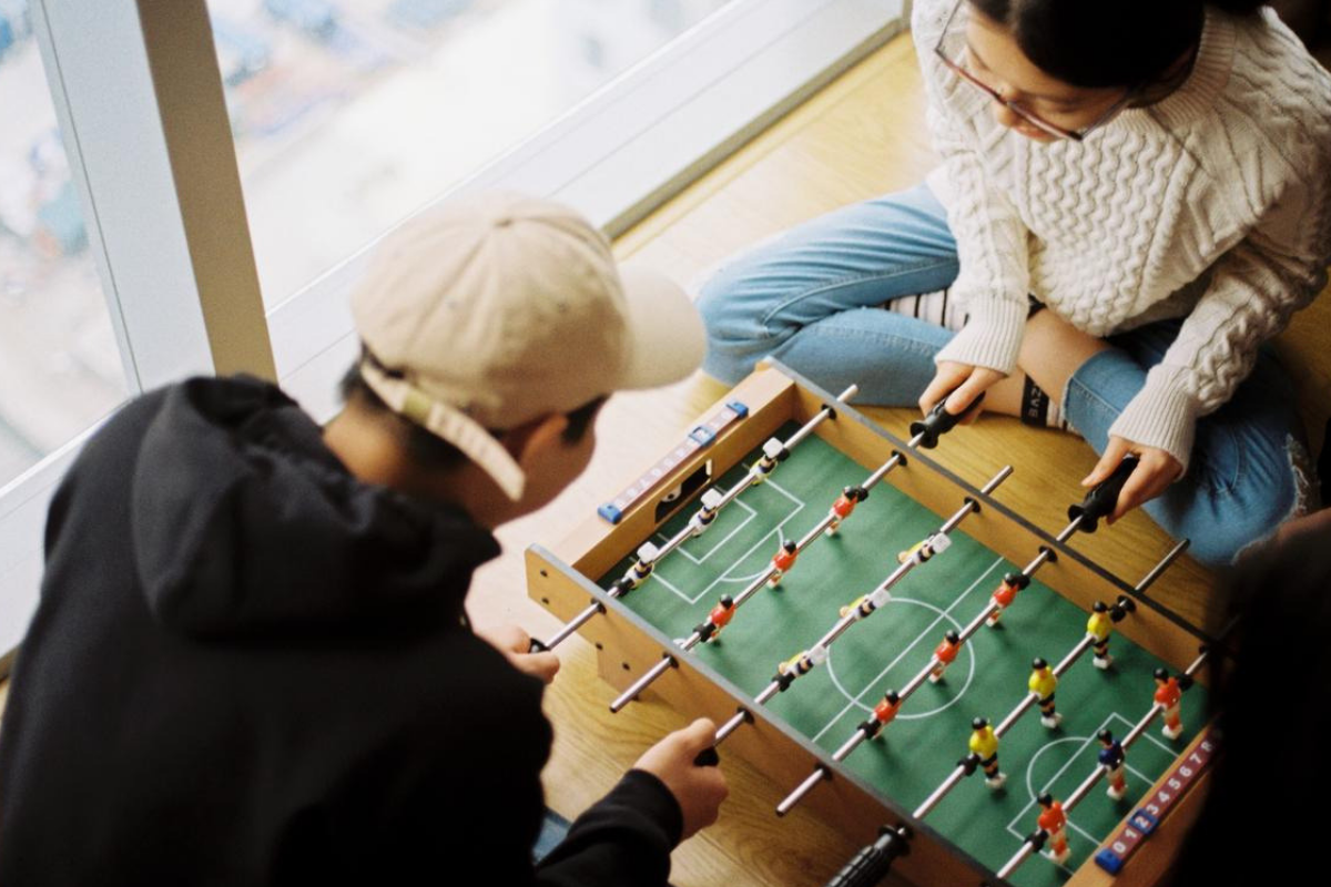 Asians playing foosball