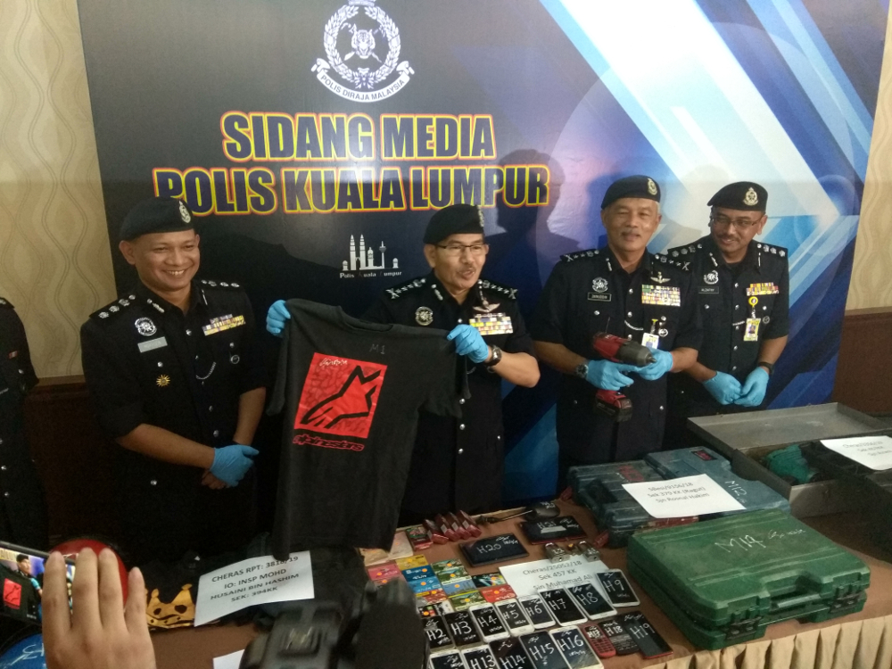 KL police chief Mazlan Lazim holding up the shirt worn by the suspect during the incident that was confiscated during a raid 19 February.