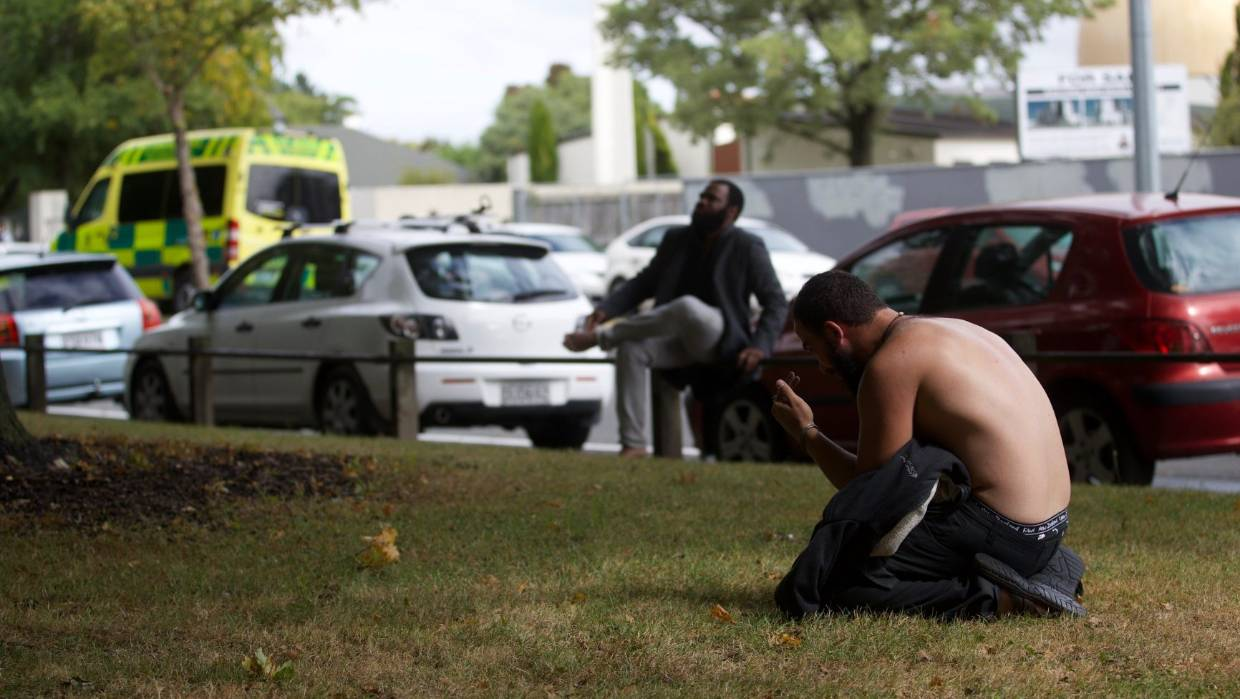 A man praying outside the Deans Ave mosque on the edge of Hagley Park.