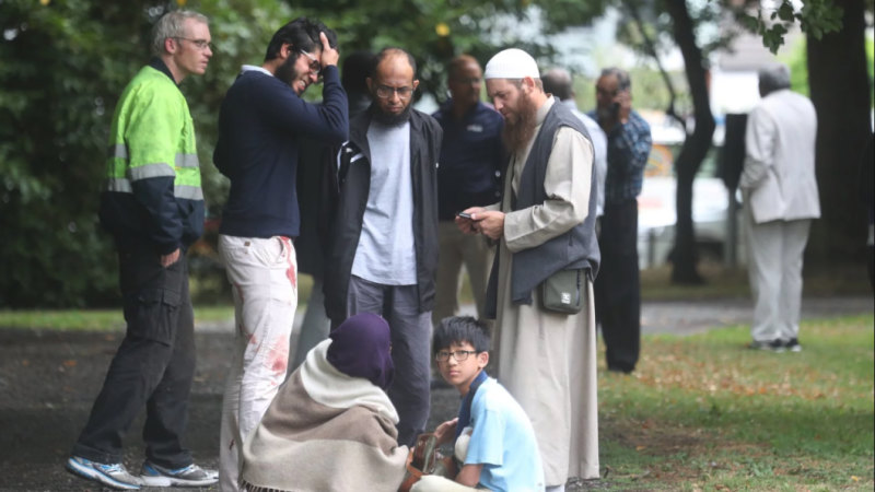 Stunned and bloodied worshippers outside one of the Christchurch mosques.